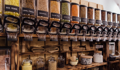 sustainable store design - shelf with raw food product in refillable containers